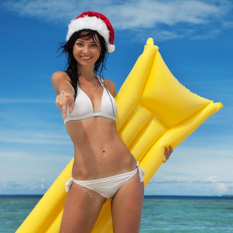 Free Happy Santa Woman With Inflatable Mattress In The Sea. Holliday Island Lifestyle. Vacation At Paradise. Ocean Beach Relax, Crystal Royalty Free Stock Photos - 159012698