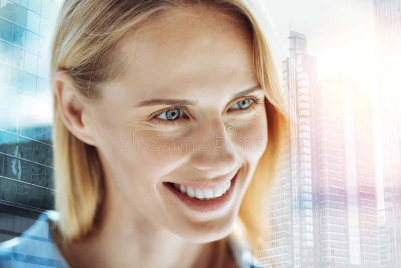 Happy satisfied lady feeling good herself and looking aside. stock image