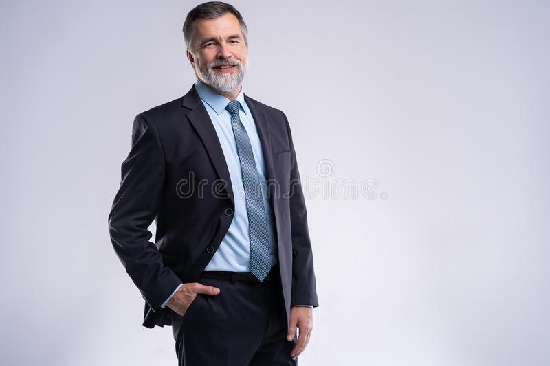Happy satisfied mature businessman looking at camera isolated on white background. Happy satisfied mature businessman looking at camera isolated on white stock photography
