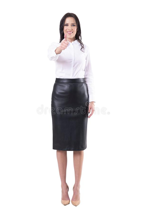 Happy satisfied smiling young adult business woman showing thumb up at camera royalty free stock photo