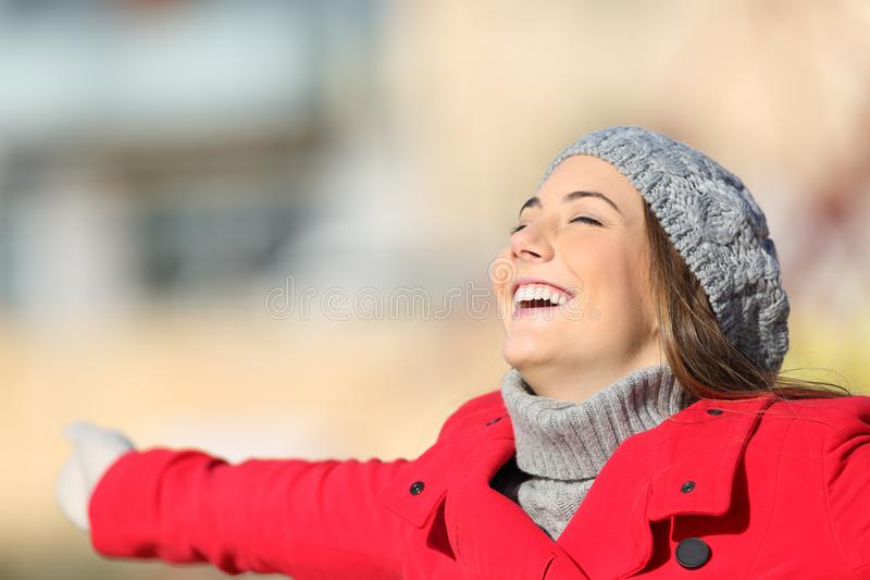 Happy satisfied woman breathing fresh air in winter stock image