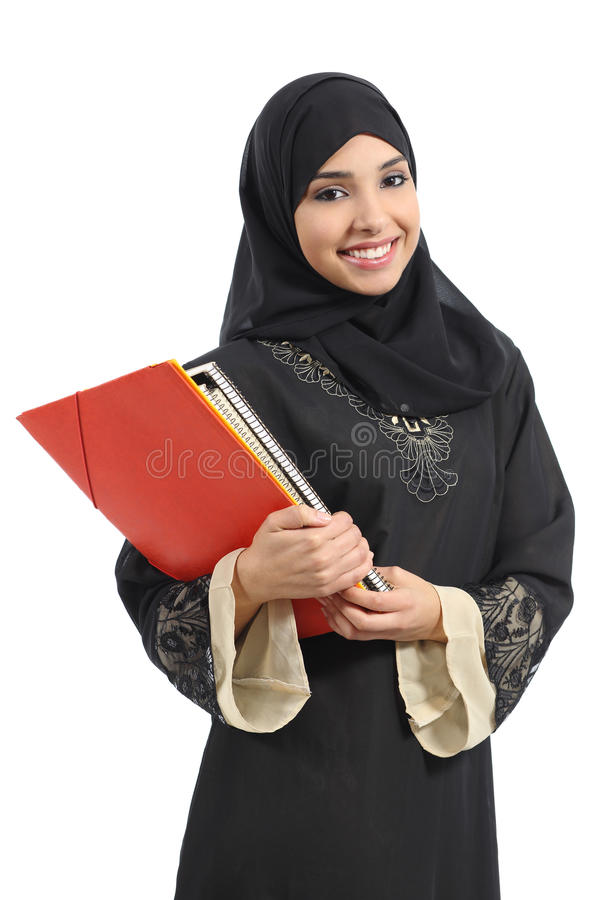 Happy saudi Arab student holding folders. Isolated on a white background royalty free stock photo