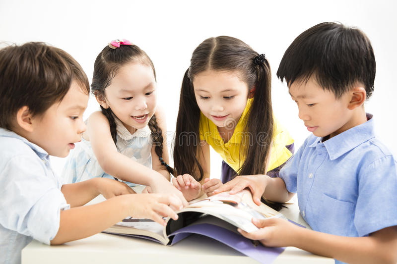 Happy school kids studying together. Group of school kids studying together stock image
