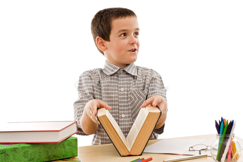 Happy schoolboy with books. Happy schoolboy close an old book - isolated royalty free stock photos