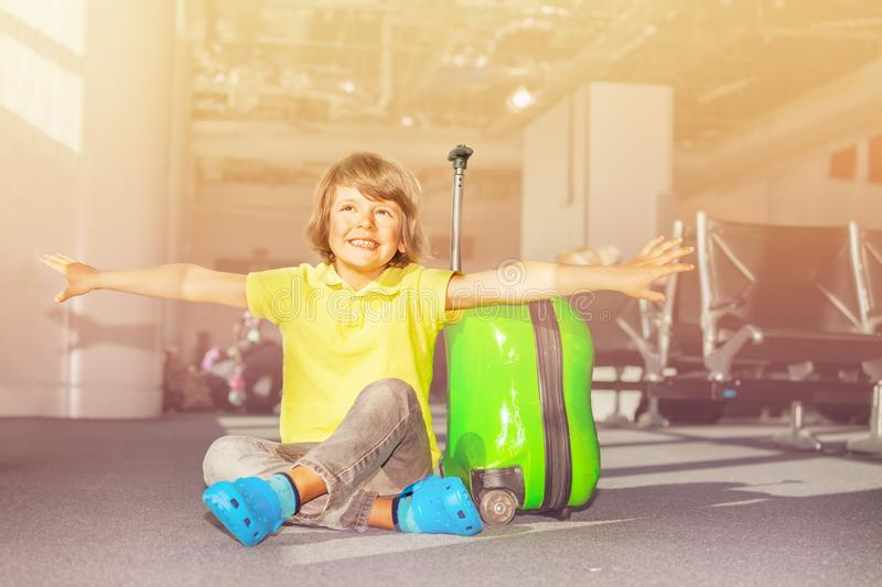 Happy schoolboy with hands like wings at airport royalty free stock images