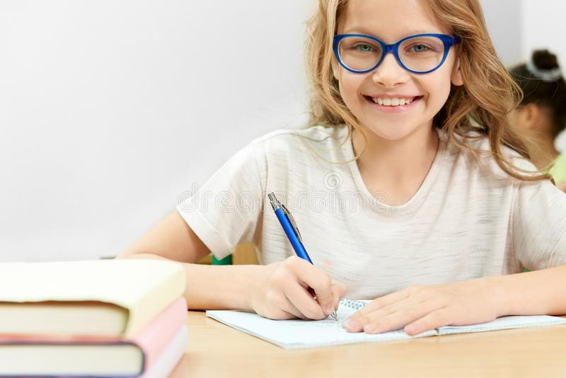 Happy schoolgirl looking at camera, smiling . royalty free stock images