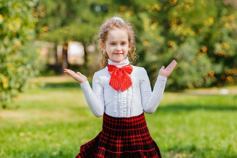 Happy schoolgirl in school uniform stock images