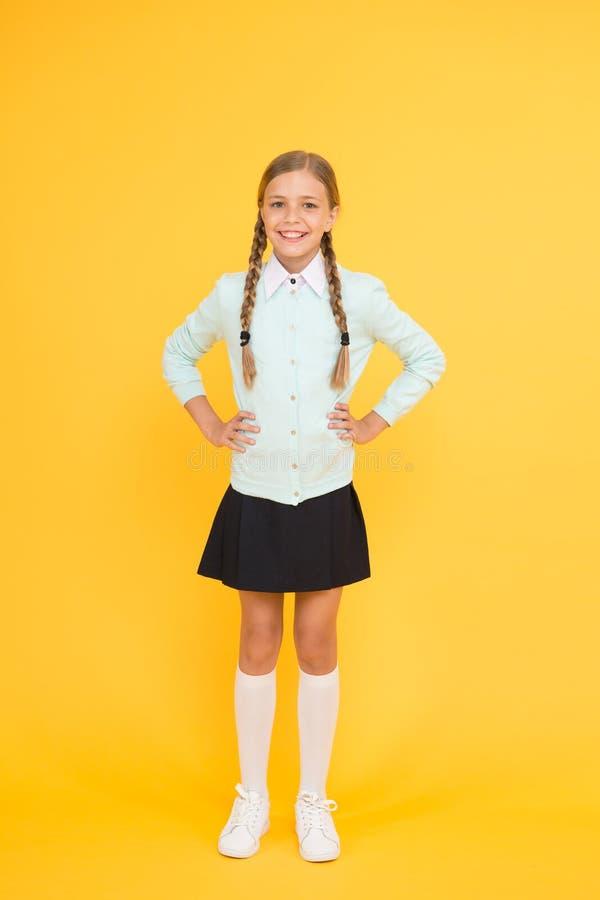 Happy schoolgirl. Schoolgirl happy smiling pupil long hair. Beginning of academic year. Educational activity. Homeschooling or visiting regular school royalty free stock photo