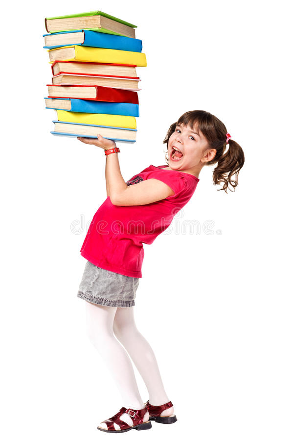Happy Schoolgirl With A Stack Of Heavy Books Royalty Free Stock Photos