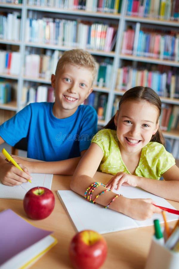 Happy schoolkids stock photos