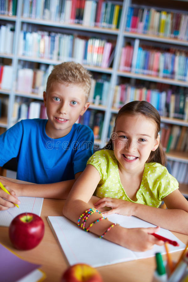 Happy schoolkids stock image