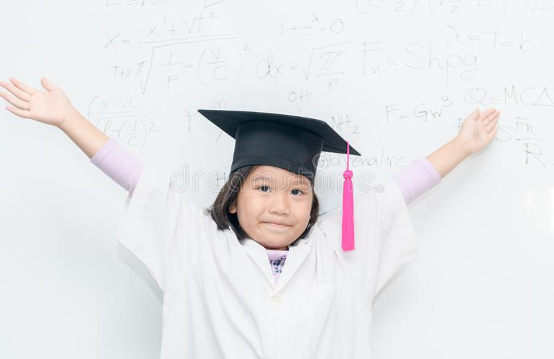 Happy scientist girl wear graduation hat. royalty free stock photo