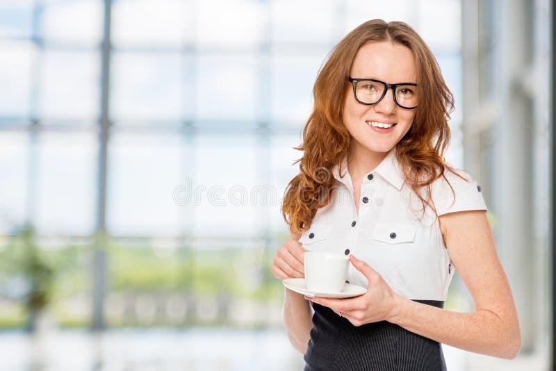 Happy secretary with coffee stock photo