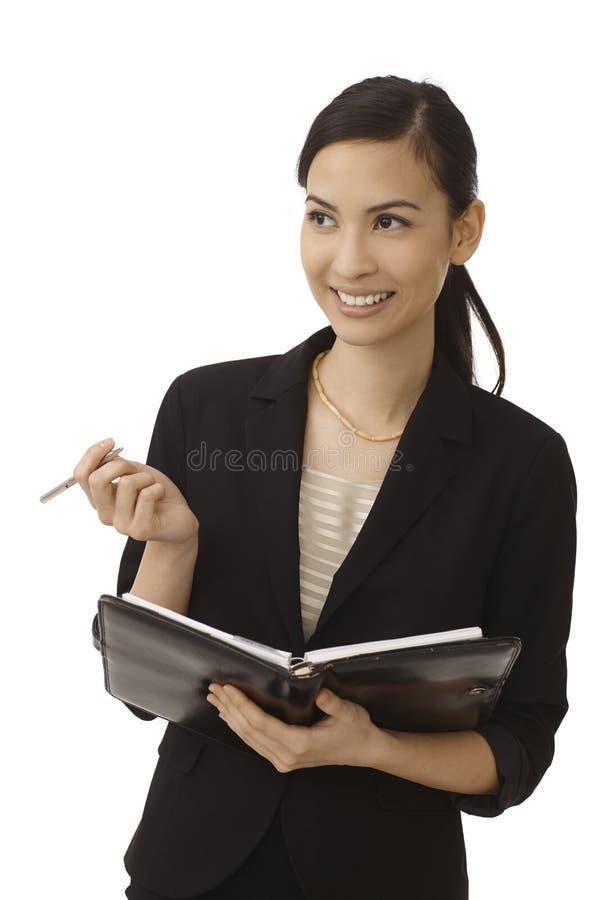 Happy secretary making notes royalty free stock photography