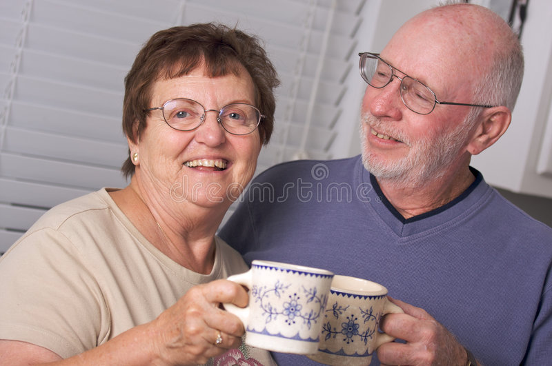 Happy Senior Adult Couple. Portrait with Coffee Cups royalty free stock photo
