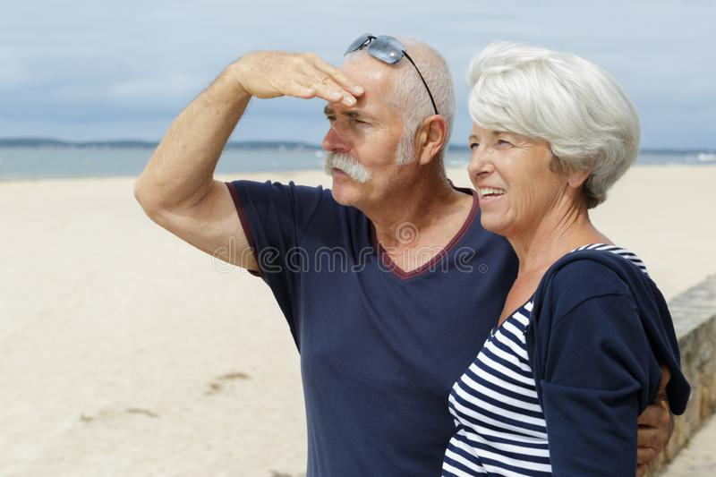 Happy senior adult couple tourists looking at something royalty free stock photos