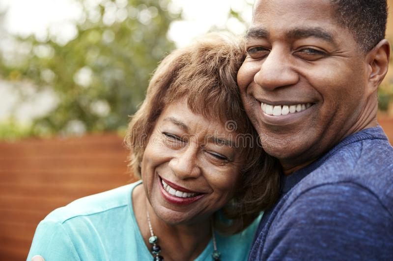 Happy senior African American  woman and her middle aged son embracing, head and shoulders, close up royalty free stock images