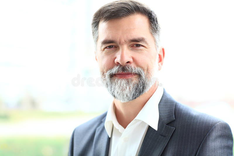 Happy senior business man smiling royalty free stock photo