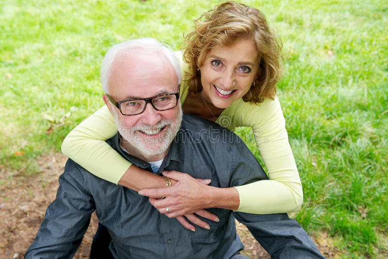 Happy senior caucasian couple smiling outdoors royalty free stock photo