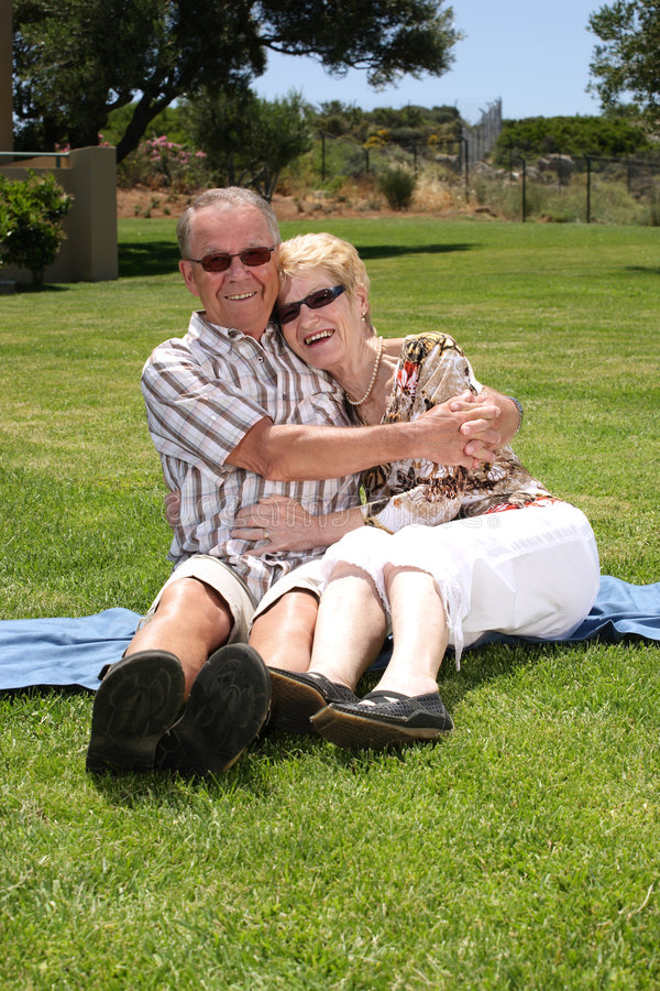 Happy senior couple. Relaxing outdoors royalty free stock photo