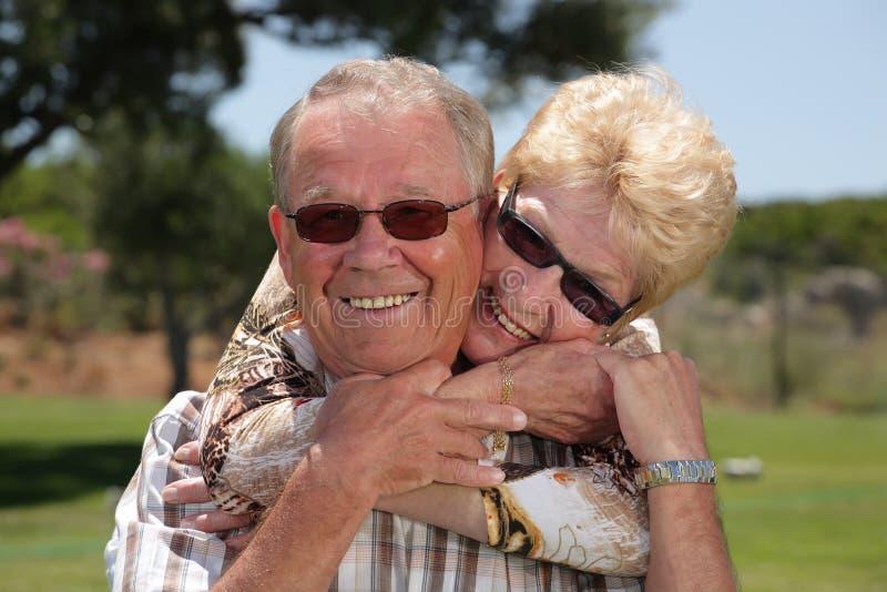 Happy senior couple. Having fun outdoors royalty free stock images