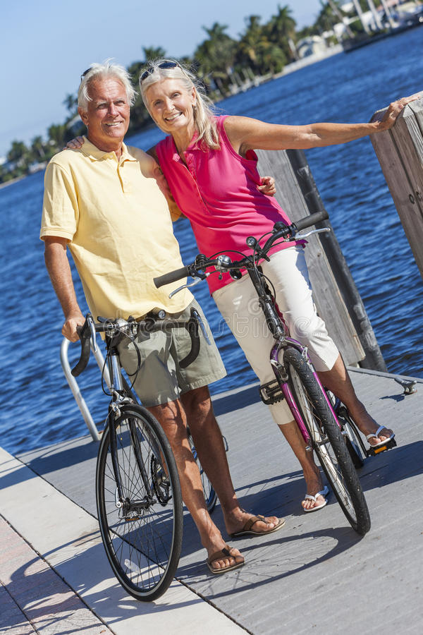 Download Happy Senior Couple On Bicycles By A River Stock Image - Image of active, cycling: 31391979