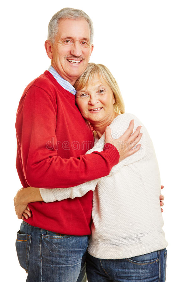 Happy senior couple embracing each other stock photo