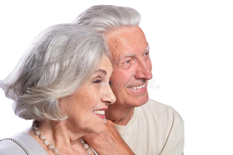 Happy senior couple embracing and posing on white background. Happy senior couple embracing and posing isolated on white background stock photos