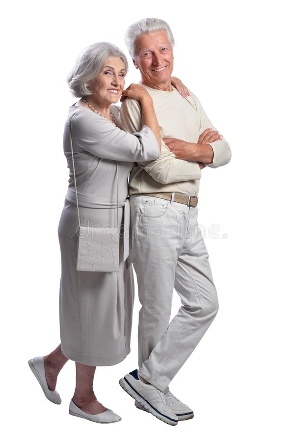 Happy senior couple embracing and posing on white background. Happy senior couple embracing and posing isolated on white background royalty free stock photography