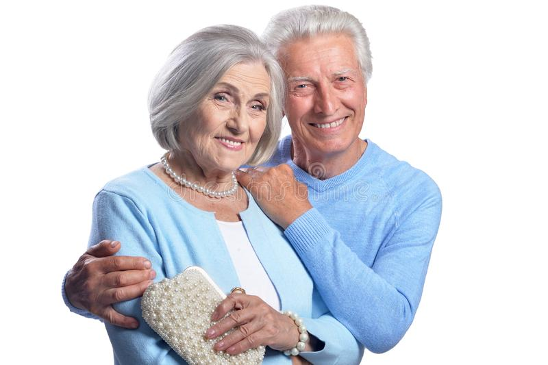 Happy senior couple embracing and posing on white background. Happy senior couple embracing and posing isolated on white background stock images