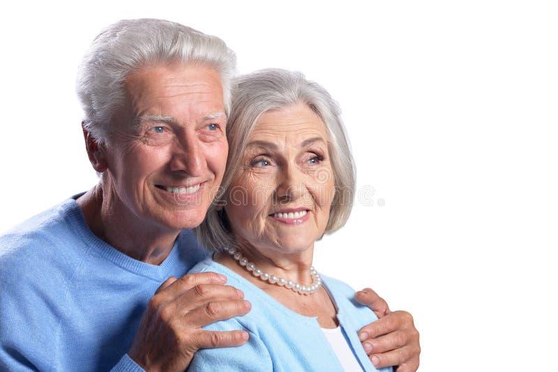 Happy senior couple embracing and posing on white background royalty free stock image
