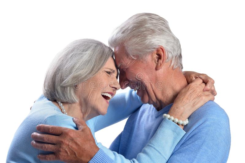 Happy senior couple embracing and posing on white background royalty free stock images