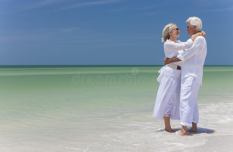 Download Happy Senior Couple Embracing On Tropical Beach Stock Photo - Image: 29202302