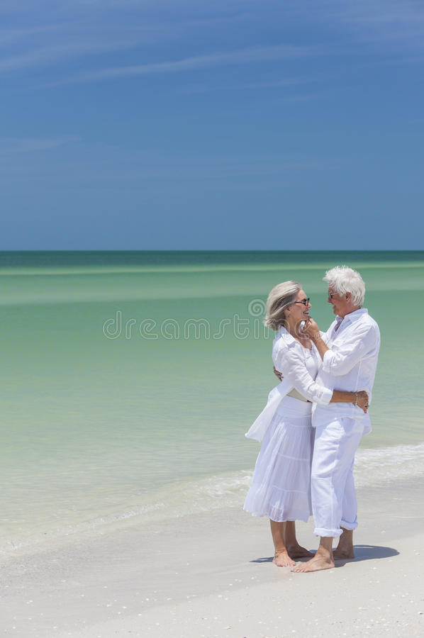 Happy Senior Couple Embracing On Tropical Beach Stock Photography
