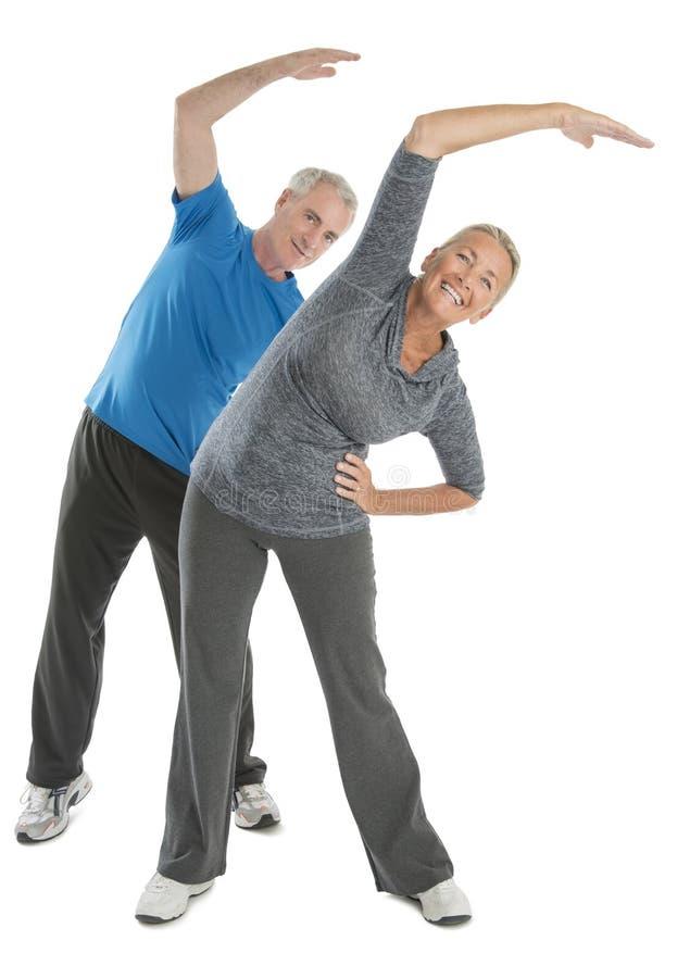 Happy Senior Couple Exercising Stock Image