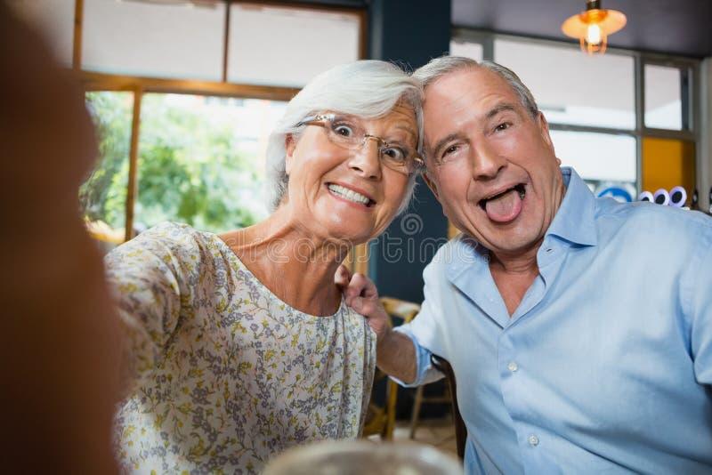Happy senior couple having fun stock photography