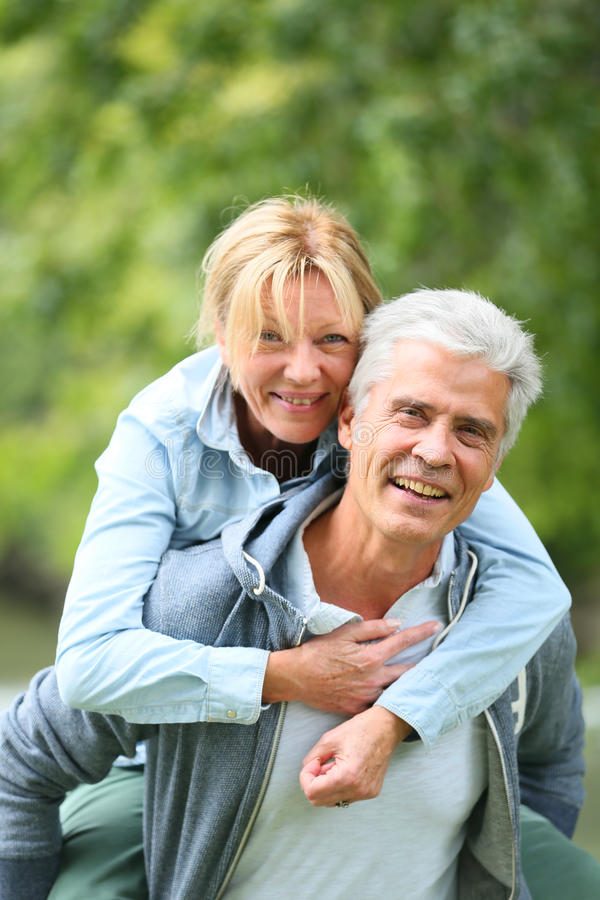 Happy senior couple having fun outdoors stock photography