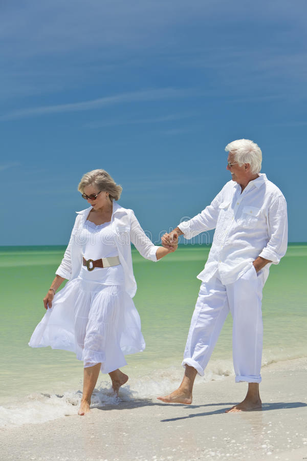 Download Happy Senior Couple Holding Hands On A Beach Stock Photography - Image: 17146382