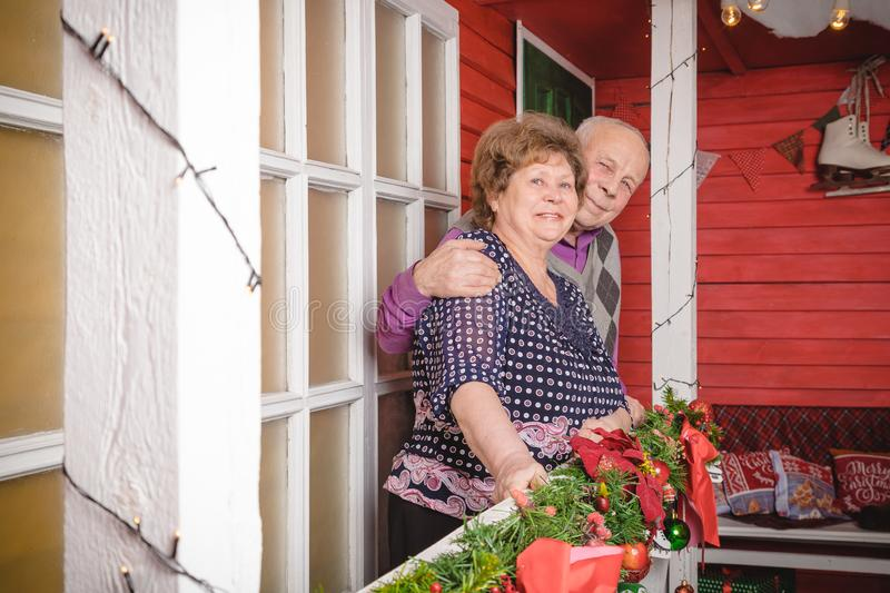 Senior couple at home in the room decorated for Christmas and New year stock images