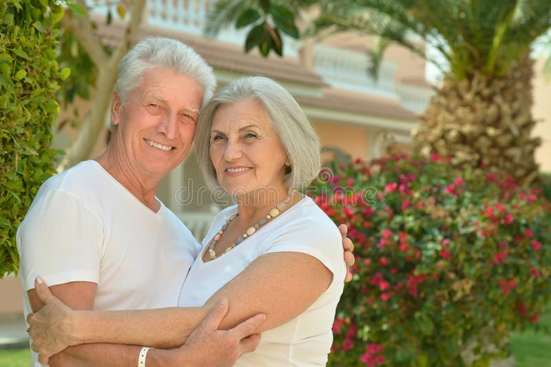 Senior couple at hotel resort hugging. Happy Senior couple at hotel resort hugging royalty free stock photography