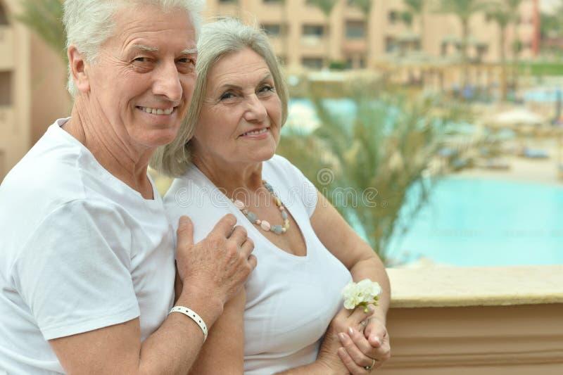 Senior couple at hotel resort hugging. Happy Senior couple at hotel resort hugging stock images