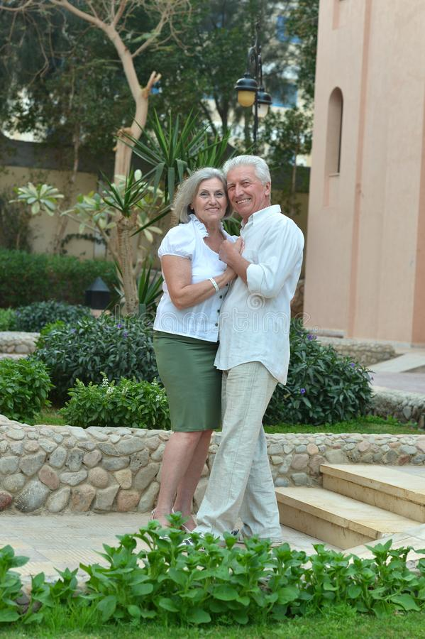 Senior couple at hotel resort hugging. Happy Senior couple at hotel resort hugging royalty free stock photo