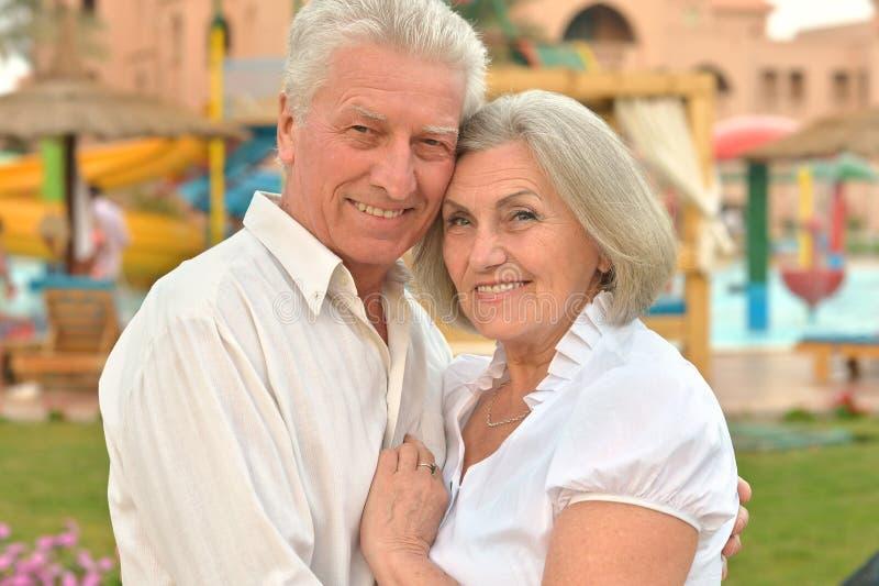 Senior couple at hotel resort hugging. Happy Senior couple at hotel resort hugging royalty free stock photos