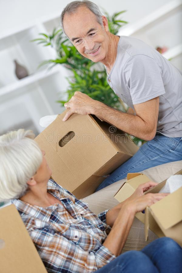 Happy senior couple moving into their new home stock image