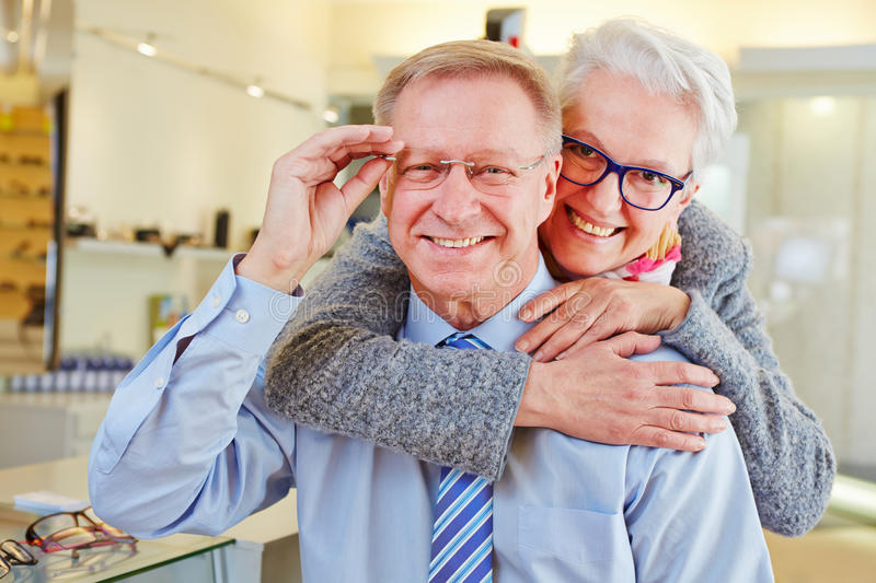 Happy senior couple with new stock image