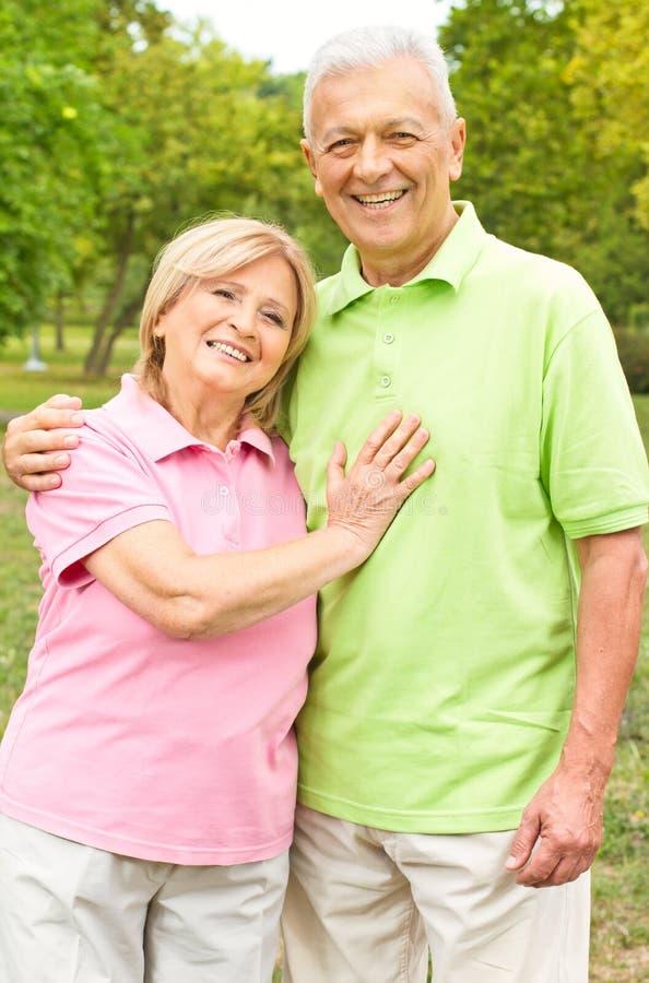Happy senior couple outdoors stock images