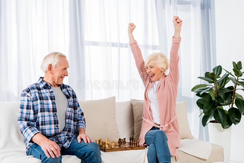 happy senior couple playing chess at home royalty free stock photography