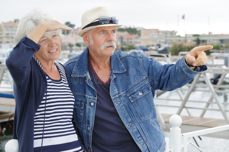 Happy senior couple in port stock photos