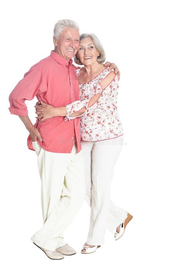 Happy senior couple posing on white background. Happy senior couple posing isolated on white background royalty free stock photo