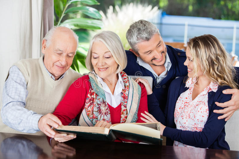 Happy Senior Couple Reading Book With stock photography
